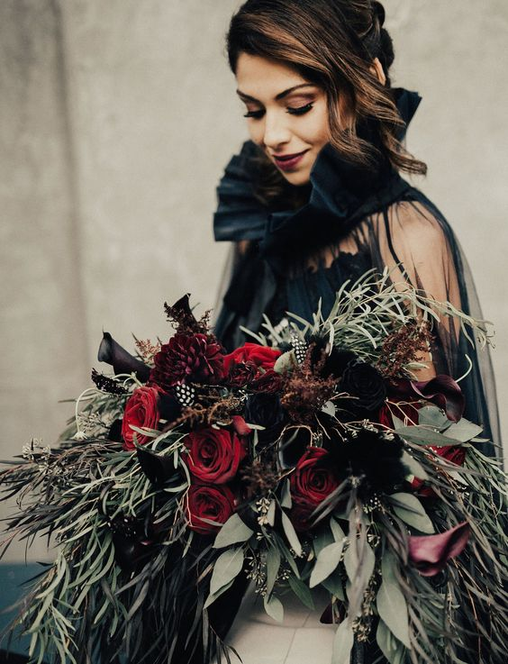 deep red and black callas wedding bouquet with cascading greenery of various kinds