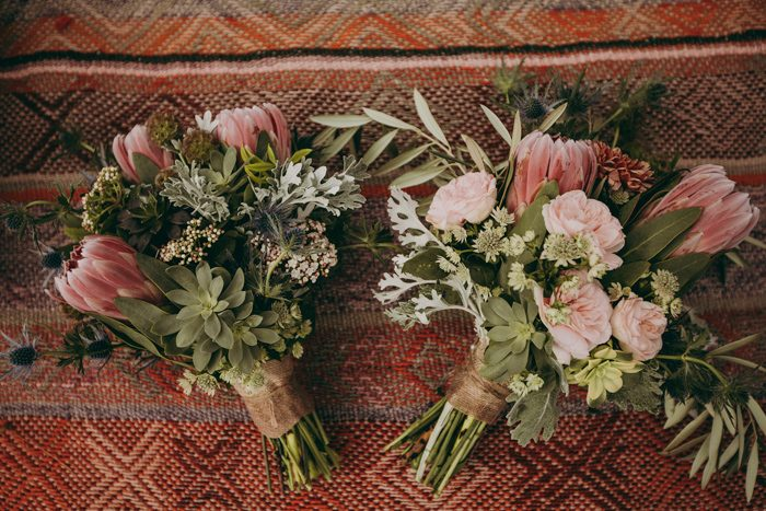 The bridal bouquets were done with dusty pink proteas, greenery and succulents