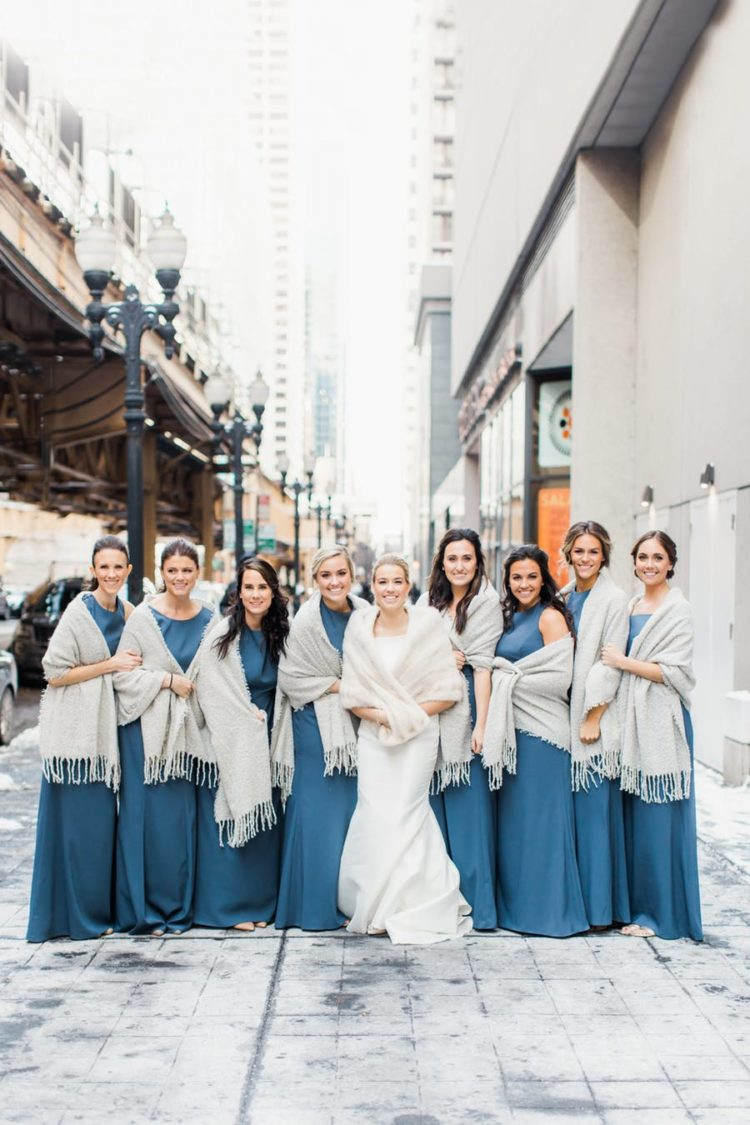 The bridesmaids were rocking muted blue dresses and covered up with pashminas