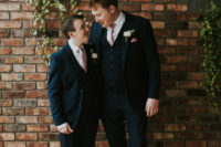05 The groom and groomsman were rocking classic navy three-piece suits with pink touches