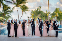 05 The groomsmen were rocking black tuxedos and the bridesmaids were wearing pink strapless maxi gowns