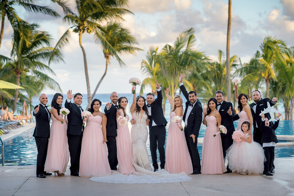 The groomsmen were rocking black tuxedos and the bridesmaids were wearing pink strapless maxi gowns