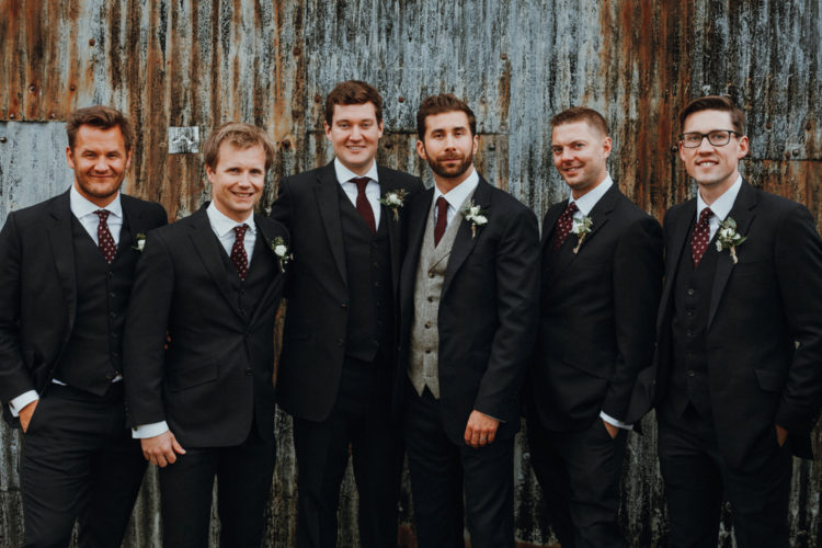The groomsmen were wearing three-piece suits  with polka dot ties