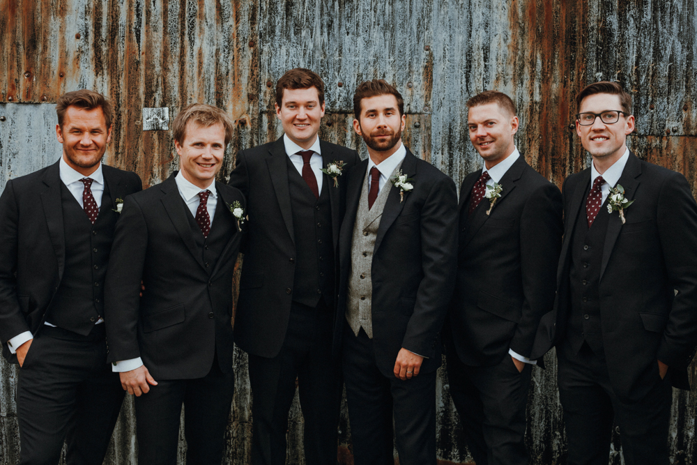 The groomsmen were wearing three piece suits  with polka dot ties