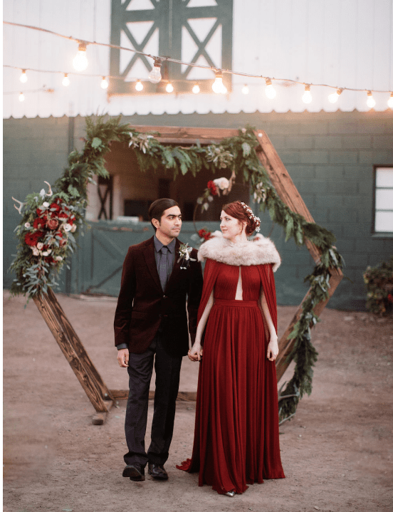 The wedding arch was a hexagon of wood decorated with greenery, blooms and antlers
