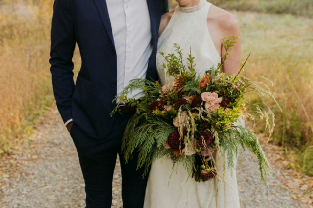 The wedding bouquet was done with moody and blush blooms and a lot of fern and other herbs