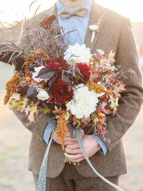 a fall-inspired dark wedding bouquet with leaves, herbs and white and burgundy blooms