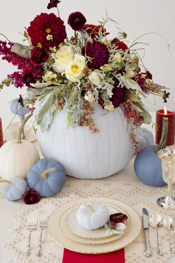 chic pastel table decor with pumpkins and a lush floral centerpiece with blooms and pale greenery