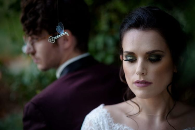 The bride was rocking a wavy updo, a green eyeshadow and muted pink lips