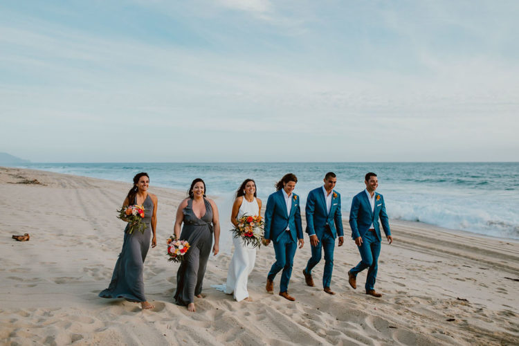 The bridesmaids were wearing grey maxi gowns with ruffles