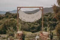 boho inspired wooden wedding arch