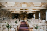 06 The ceremony space was done with white chairs and lush greenery and blooms