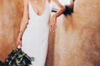 06 a minimalist plain slip wedding dress is all you need for a trendy modern bridal look