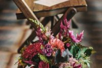 06 a moody floral arrangement in a mercury glass vase, dark pink, grey, yellow and purple for a moody fall wedding