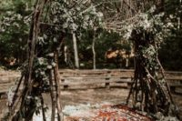 06 a really woodland wedding arch of branches, greenery, blooms, with a rug and stones for a boho wedding
