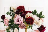 06 an elegant wedding centerpiece of white, blush and burgundy blooms and greenery
