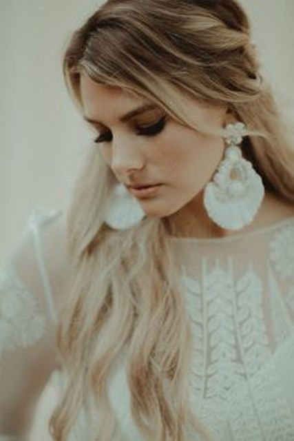 boho fringe and large white bead statement earrings make a gorgeous accent