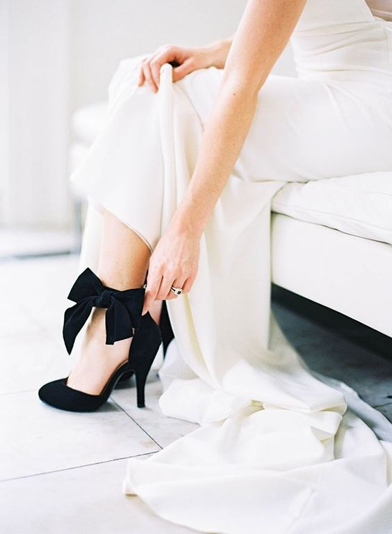 elegant black suede wedidng shoes with ankle bows bring that super chic feel to the bridal look
