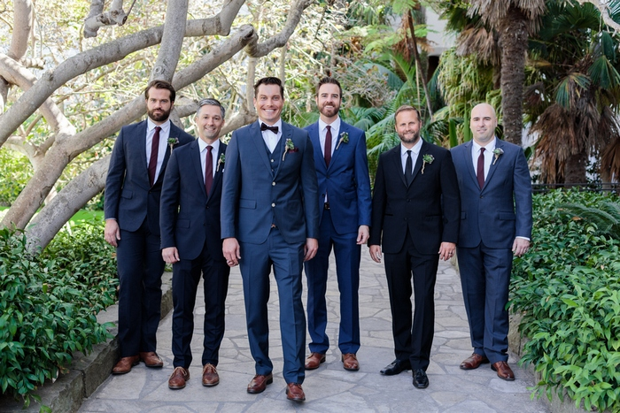 The groomsmen were rocking navy and black suits with plum-colored ties