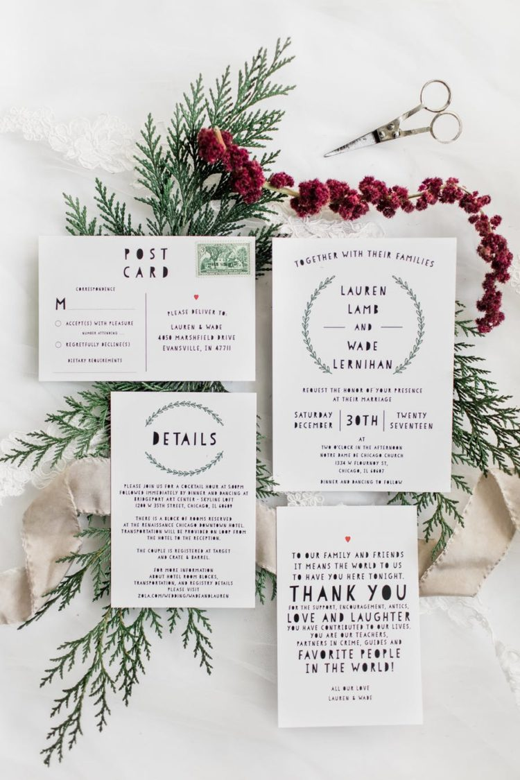The wedding invitation suite was done in black and white with touches of greenery