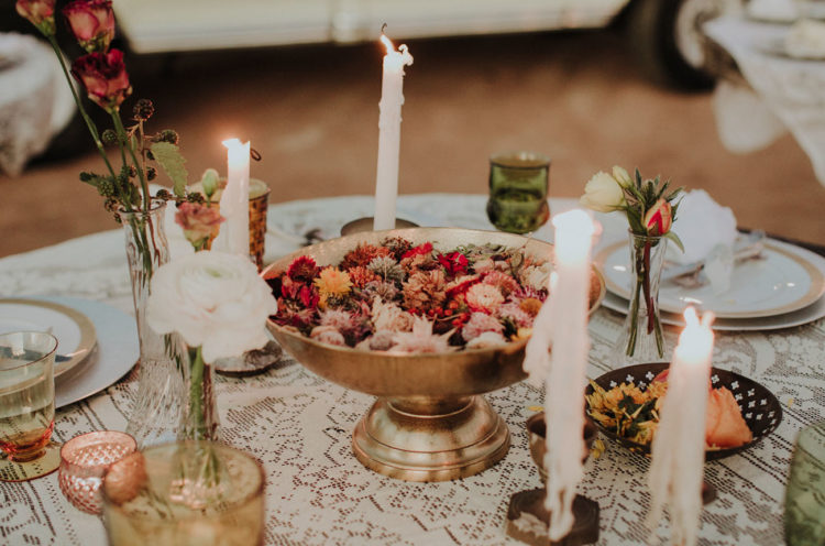 The wedding tablescape was done with lace, blooms and candles for an eclectic feel