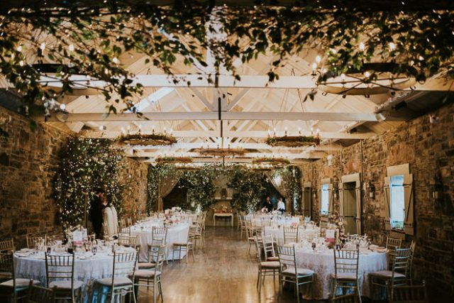 The wedding venue was decorated with lush greenery and lots of lights