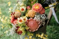 07 a gorgeous fall floral arrangement in a bucket with the shades of yellow, burgundy, red and green