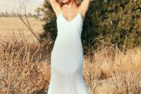 07 a minimalist slip wedding gown with an illusion skirt is a fresh take on classic slips