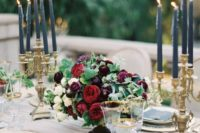 07 an elegant moody wedding centerpiece of white, ruby red and plum-colored blooms and greenery