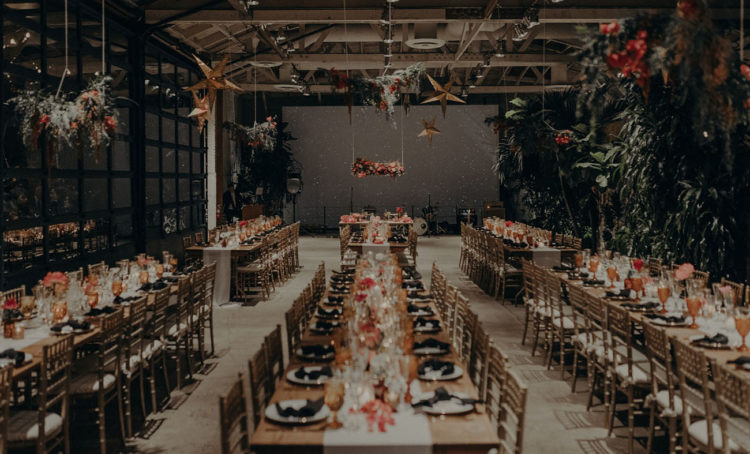 The industrial reception was enlivened with fresh greenery, bright blooms, stars and lights