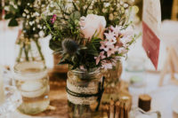 08 The tablescape was done with lush florals and some rustic touches like rough edge wood boards
