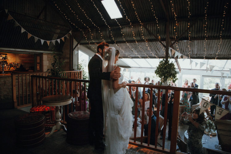 The venue was lit up with fairy lights, decorated with greenery and some neutral blooms
