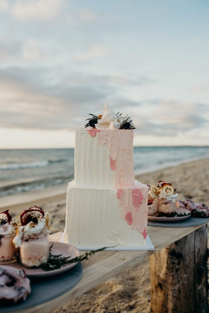 The wedding cake was a buttercream brushstroke one, with shells and blooms on top
