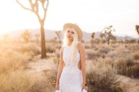 08 a boho lace wedding dress with side cutouts, tan strappy shoes and a neutral hat for a boho feel