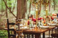 08 a boho woodland wedding reception done in jewel tones, with feathers and gold touches for a refined feel