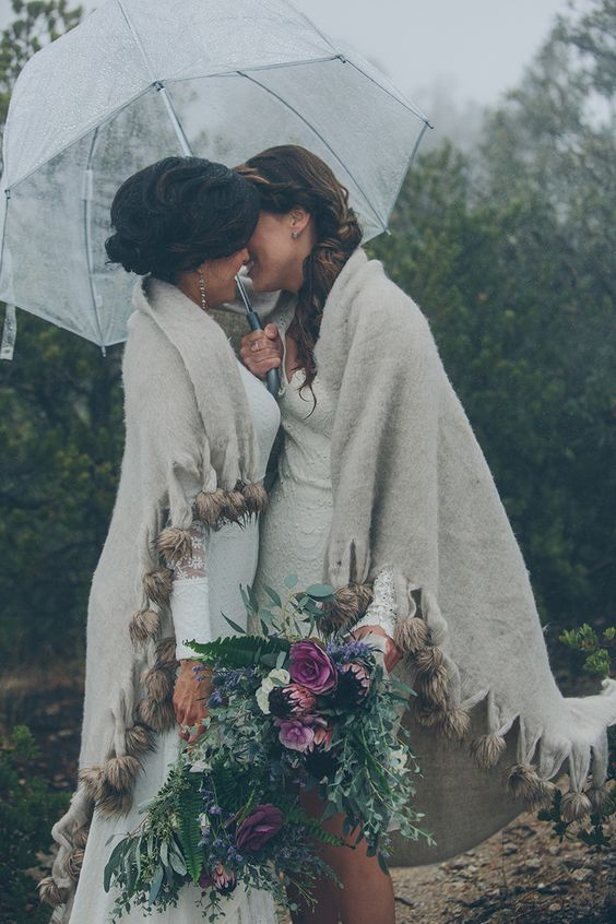 a large sheer umbrella for the couple and a common blanket coverup for more romance
