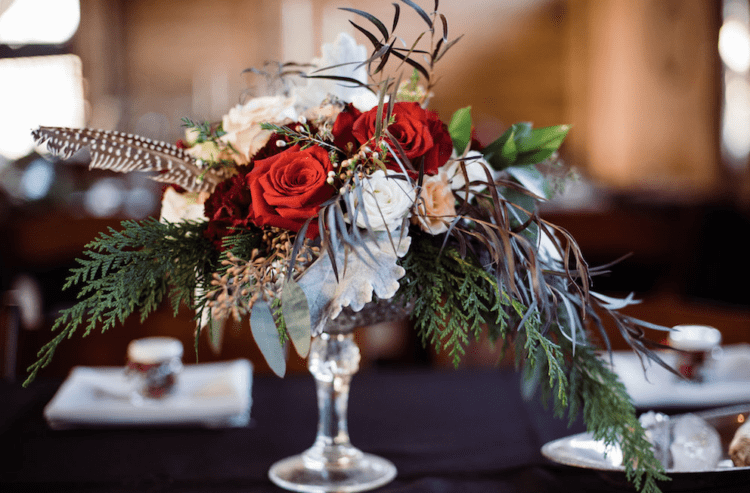 The centerpieces were lush ones, with much greenery, feathers and lush blooms