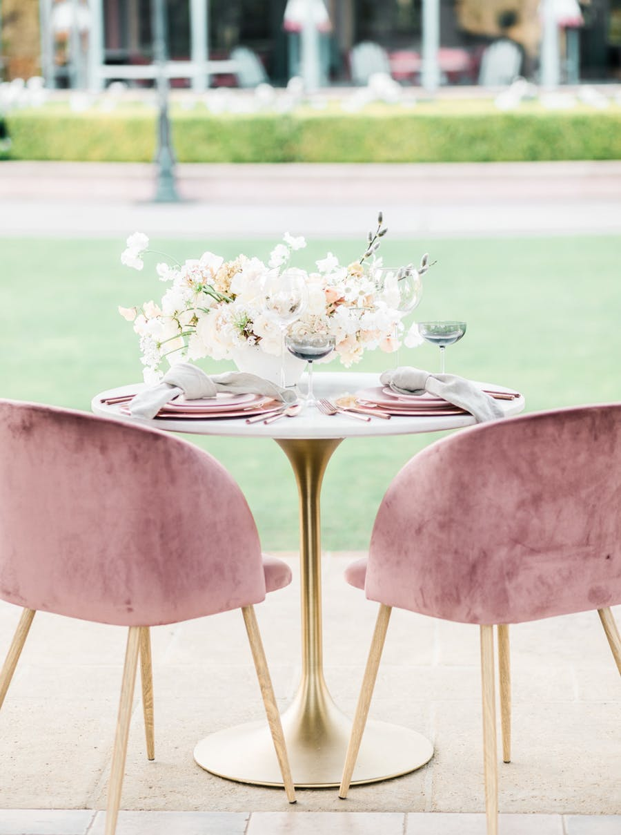 The table was styled with soked glasses, grey napkins and pink plates