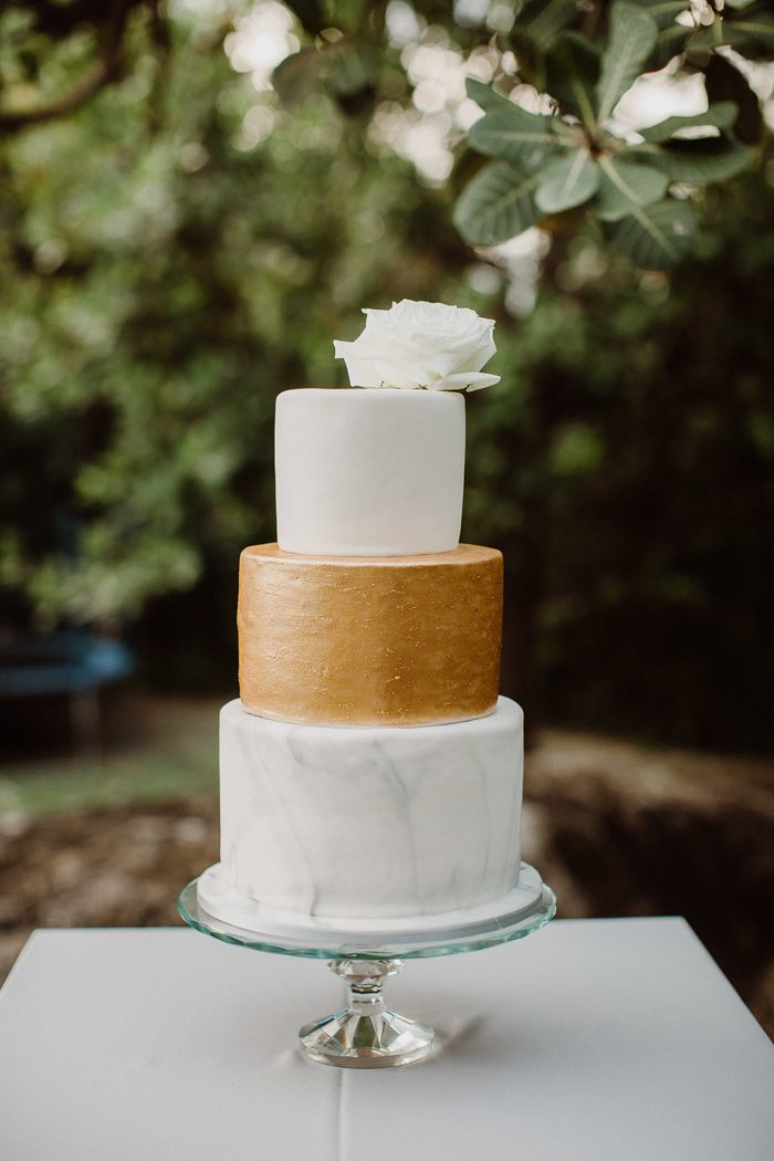 The wedding cake was a white, gold and marble one with a large bloom on top