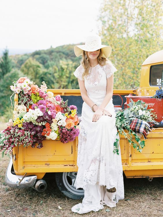 a boho lace wedding dress, leopard print shoes, an elegant vintage-inspired hat