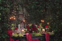 09 a dark romantic sweetheart table dressed up with moss and burgundy fabric, with greenery and red roses
