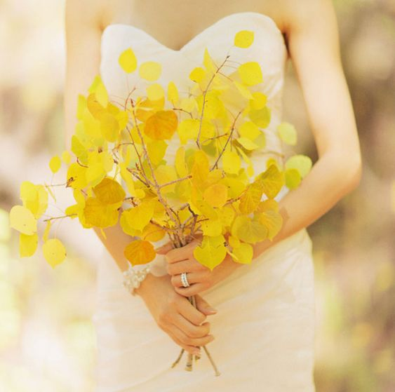 a yellow leaf wedding bouquet is a fresh take on traditional blooms for the bride