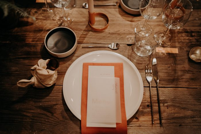 Orange and neutral napkins are right what you need for a fall-inspired wedding