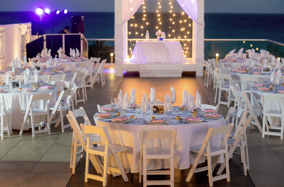 The reception was done in whites with little favors on the tables