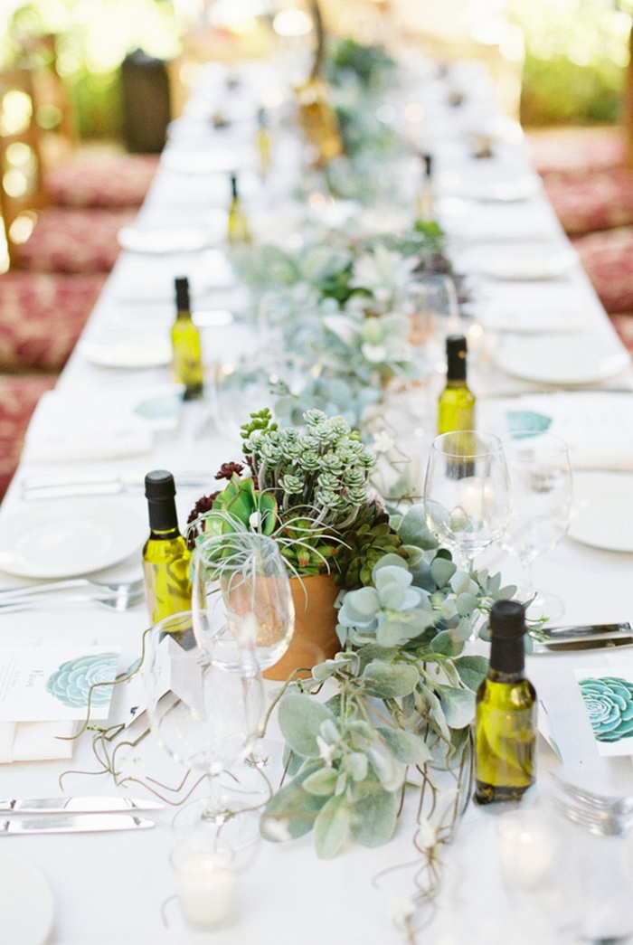 The table decor was fresh because of succulents and greenery and infused oil was given as favors