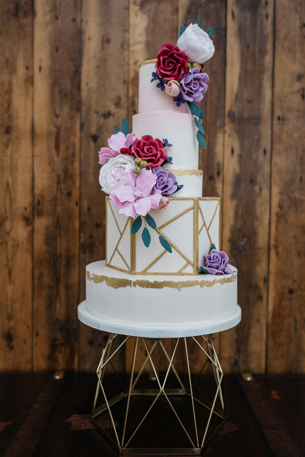 The wedding cake was a wow piece with gilded touches and sugar flowers plus some geometry