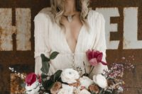 10 a boho wedding dress, a statement necklace and a off-white hat plus lush florals for a wow effect