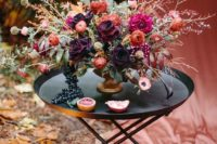 10 a dark woodland fall wedding centerpiece with branches, herbs and dark and moody blooms