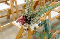 10 a lush floral arrangement with herbs and eucalyptus, burgundy and blush blooms