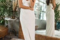 10 a modern relaxed plain slip wedding dress with a deep V-neckline plus statement earrings for an edgy look